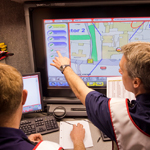Firefighters sat infront of large computer screen planning how to react to an emergency