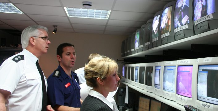 Staff watching multiple screens during training exercise