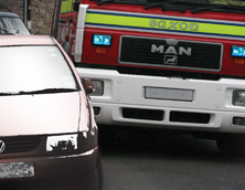 Fire engine squeezing between cars