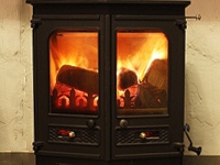 Log burner in fireplace